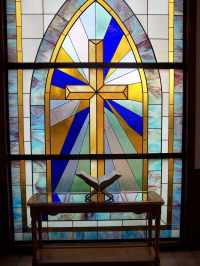 Stained glass window and Bible